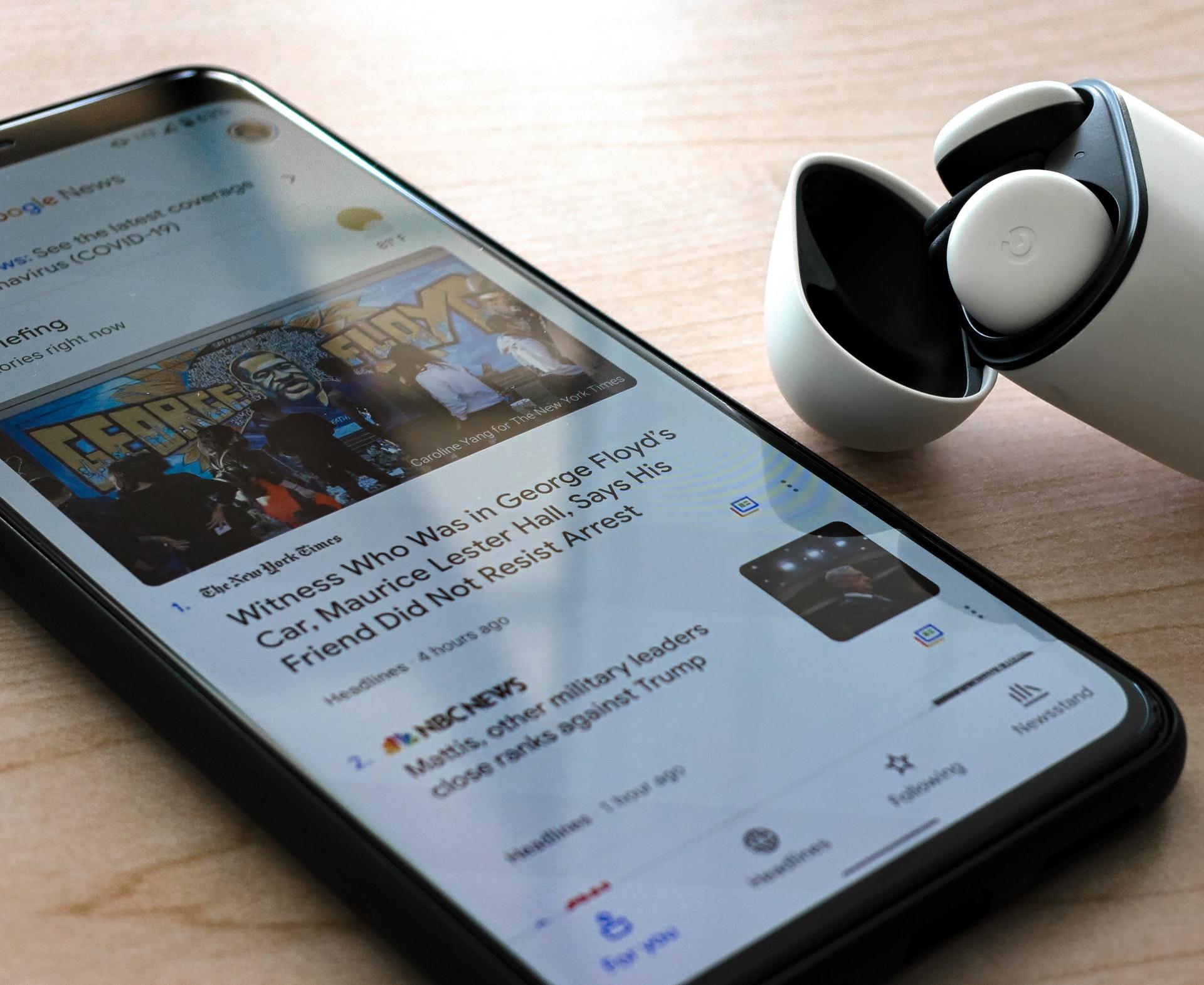 Mobile phoneshowing Google news streams